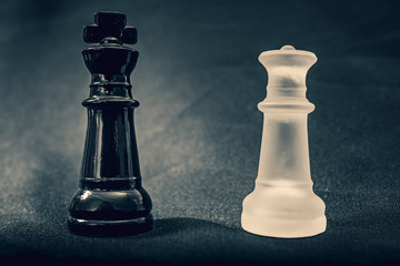 Black and white glass King and Queen chess pieces