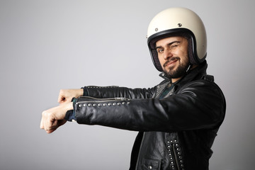 Portrait of biker with white helmet pretending ride his bike. Isolated.