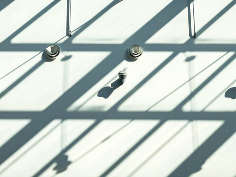 shadows of glass roof on the wall. abstract architectural background