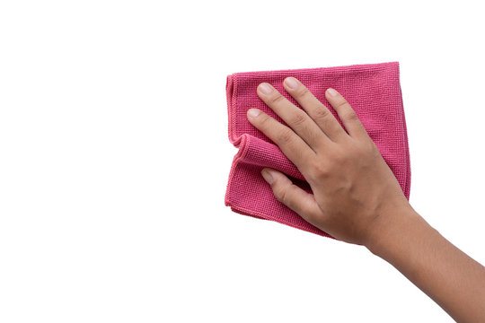 Close up woman hand holding pink duster microfiber cleaning cloth isolated on white background with clipping path. Space for your text. Top view.