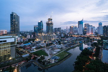 Twilight over the Jakarta business district in Indonesia capital city Papier Peint