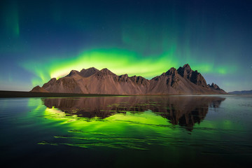 Fotobehang Nachtblauw Northern light at Vesturhorn mountain in Iceland
