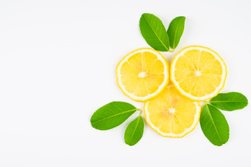 Fresh slice lemon with leaves, vitamin c supplement from natural  isolated on white background with copy space