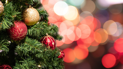 Christmas tree with decorations and lights background