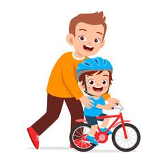 happy cute kid boy riding bike with dad