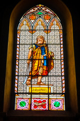 coloured stained glass window colored in a dark background church with Zerubbabel bible character