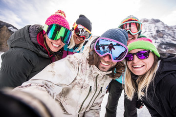 Group of snowboarders on winter holiday