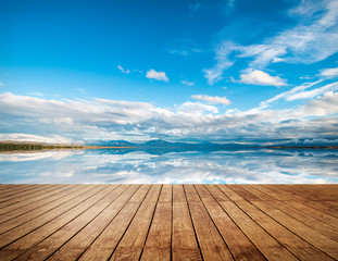 LWTWL0015057-1165-7469-1 Wooden pier with blue sea and sky background