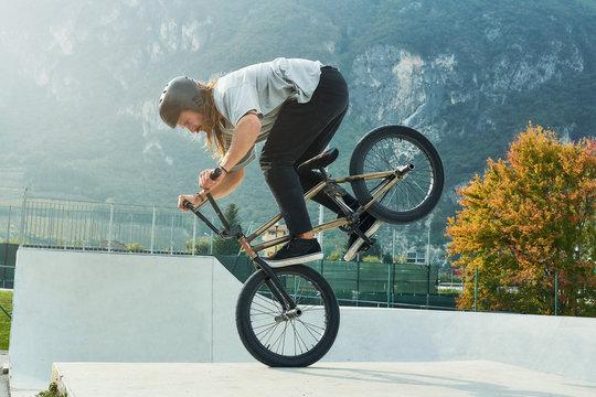 Bmx rider is making extreme stunts.