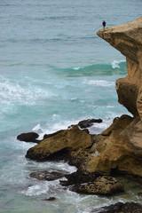 Fisher man on a cliff near Praia de Monte Clerigo, Alentejo, Portugal