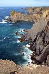 Dramatic and colorful cliffs at Praia da Arrifana (Arrifana Beach), Alentejo, Portugal