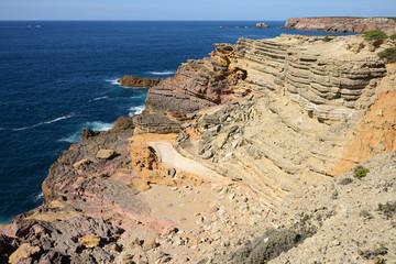 Dramatic and colorful cliffs at the Praia da Bordeira (Bordeira beach), Algarve, Portugal