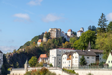 View at Fortress Veste Oberhaus and buildings on Danube shore in Passau, Bavaria, Germany in autumn