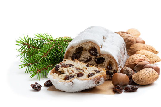 Traditional Christmas stollen fruit cake isolated on white