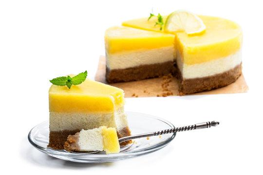 Slice of homemade lemon cheesecake isolated on white