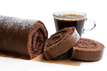 Chocolate yule log christmas cake with cup of coffee isolated on white
