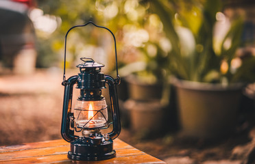 vintage lantern hanging on the table in the evening