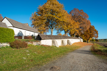 The countryside of Ostergotland at Risinge Old Church during autumn in Sweden