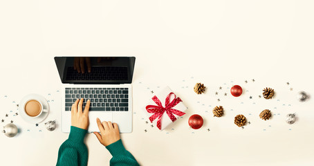 Christmas ornaments with person using a laptop computer - overhead view