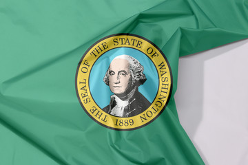 Washington fabric flag crepe and crease with white space. The state seal, displaying an image of state namesake George Washington on green.