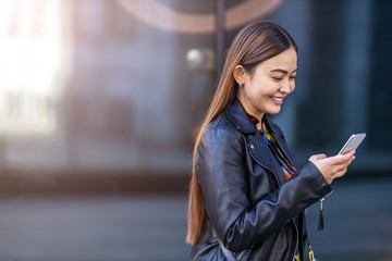 Attractive young woman with smartphone