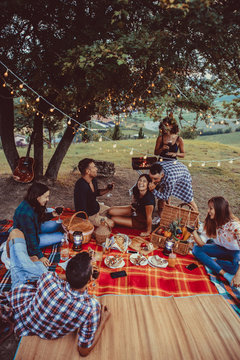 Group of friends eating in the nature