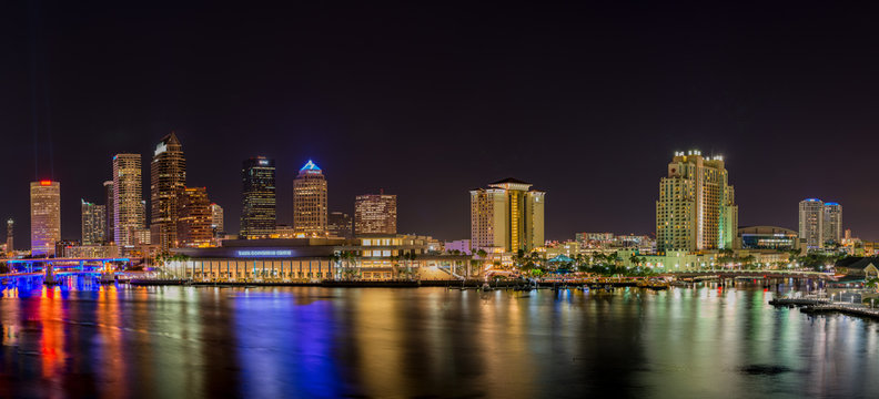 Downtown Tampa skyline with Tampa Bay in the foreground, photographed at night.