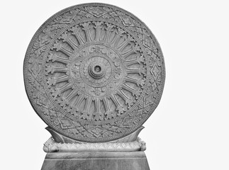 The Thammachak wheel is carved from stone as a symbol of Buddhism, isolated on white background.