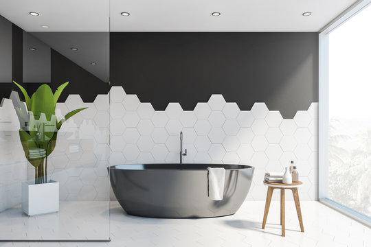 Black and white tile bathroom interior, tub