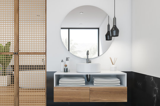 Black marble and white bathroom, tub and sink