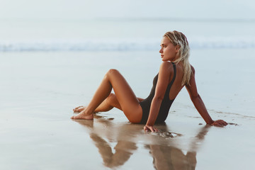 young slim beautiful woman on sunset beach, , summer vacation, sunny