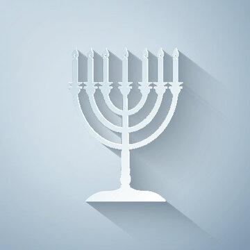 Paper cut Hanukkah menorah icon isolated on grey background. Religion icon. Hanukkah traditional symbol. Holiday religion, jewish festival of Lights. Paper art style. Vector Illustration