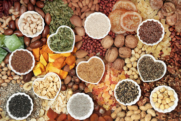 Dried fruit nut and seed collection forming a background. Health food high in antioxidants, protein, omega 3. minerals, vitamins and anthocyanins. Flat lay.