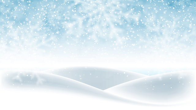 Christmas background, blue winter sky with falling snow and huge snowdrifts. Beautiful winter landscape, holiday scene with falling snowflakes for greeting card, wallpaper