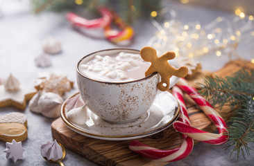 Hot chocolate cacao drinks with marshmallows in Christmas mugs on grey background. Traditional hot...
