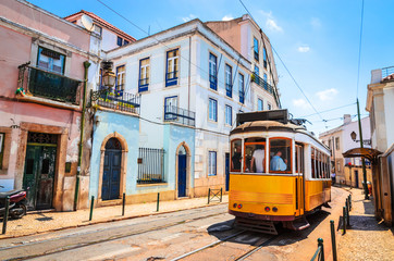 Famous vintage tram in the street of Alfama, Lisbon, Portugal Wall mural
