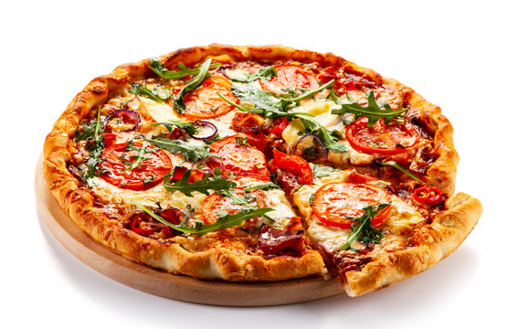 Pizza with ham, rucola, and vegetables on white background