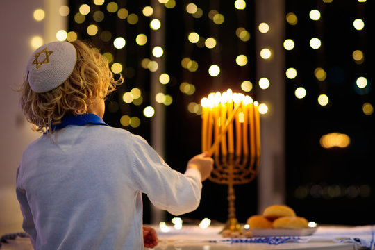 Kids celebrating Hanukkah. Festival of lights.
