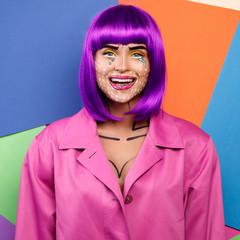 Model in creative image with pop art makeup