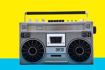 1980s Silver retro radio boom box on color background