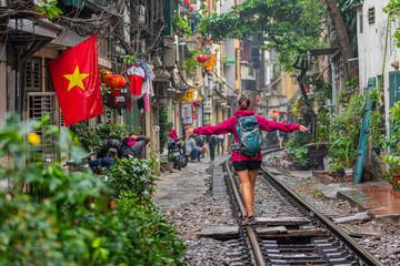 Woman walking on the railway in Hanoi, Vietnam