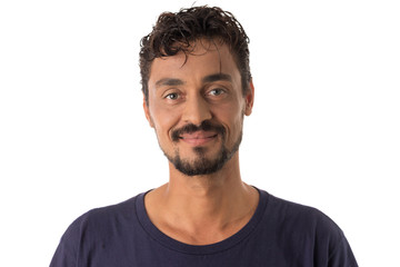 mixed race man looking happily in camera. Standing against white background.