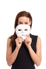 Young woman taking off mask from face isolated