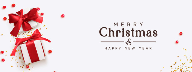 Merry Christmas and Happy New Year. Background with realistic festive gifts box. Xmas present. red berries balls, glitter red confetti. Horizontal festive poster, headers for website