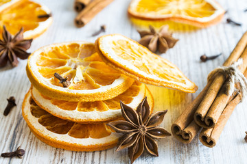 Christmas spices - cinnamon sticks, star anise, cloves and slices of dried orange on old wooden background. Fototapete