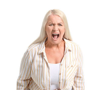 Angry mature woman on white background