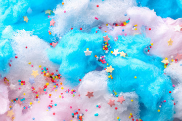 Tasty cotton candy with sprinkles, closeup