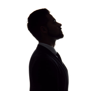 Silhouette of handsome businessman on white background