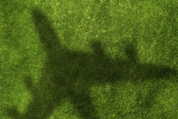 Photo sur Aluminium Vert Airplane shadow on green field