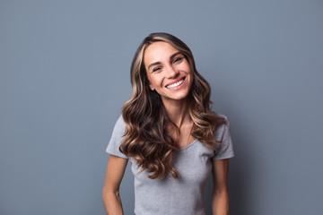 Beautiful woman smiling. Wall mural